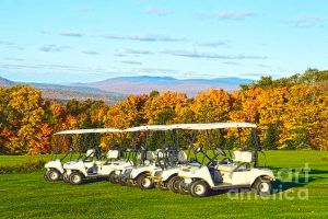 Golf carts are lined up ready for golfers on this Northeast Kingdom golf course in Vermont. It's a beautiful Autumn day!